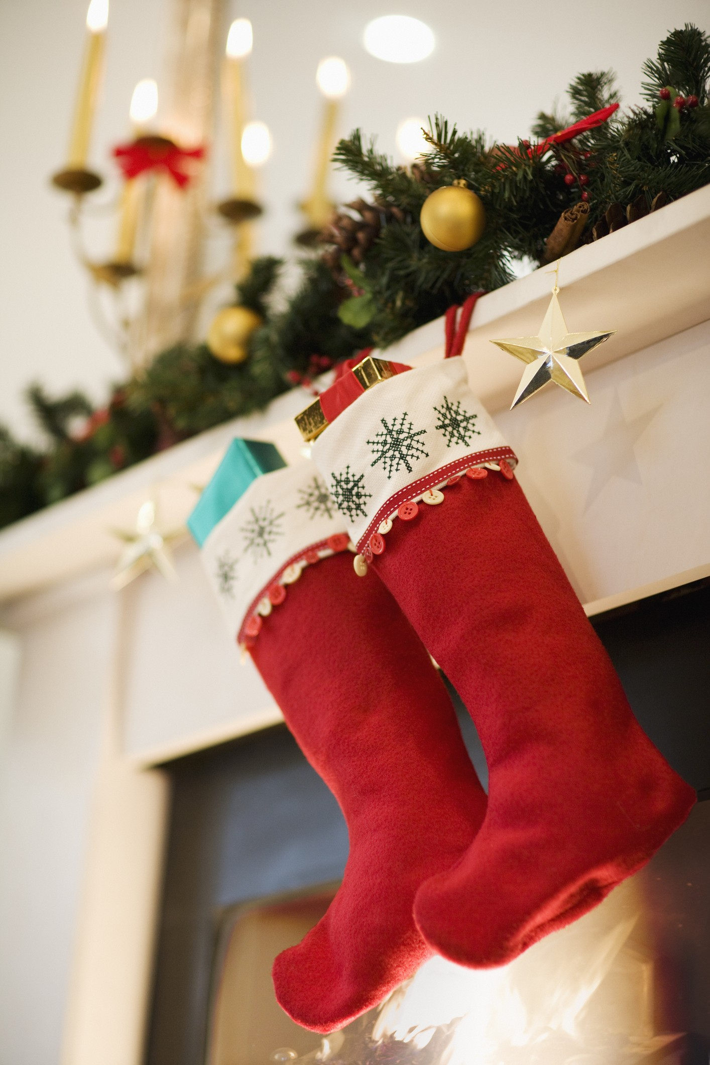 Christmas stockings hanging on fireplace mantel