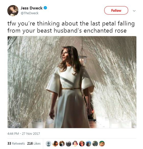 melania in white stick forest in white dress