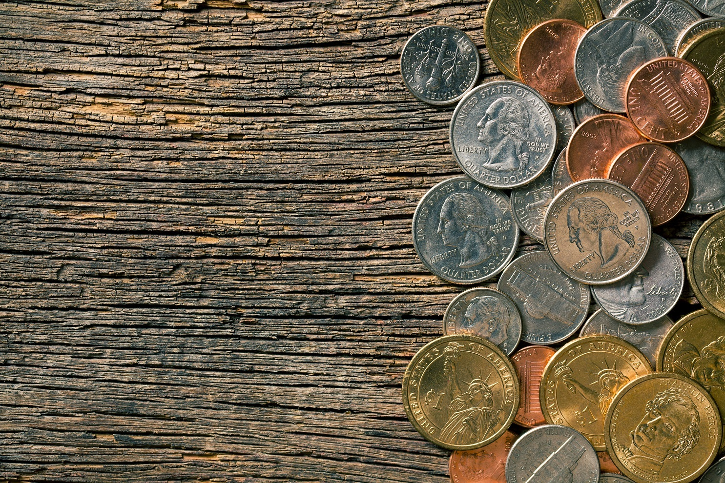 U.S. coins on old wooden background