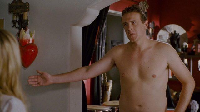 Jason Segal lifting his arm while standing naked in 'Forgetting Sarah Marshall'.