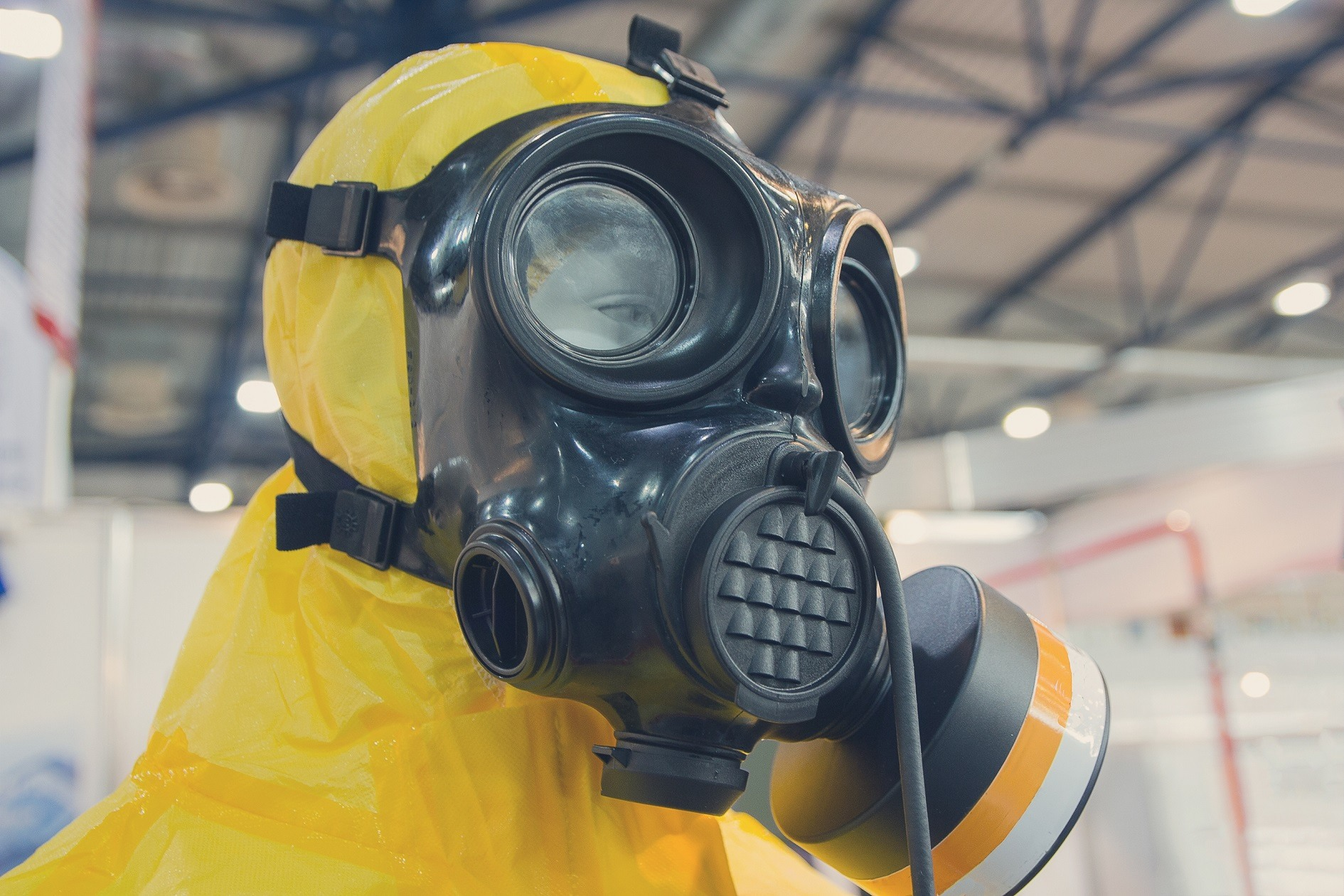 Gas mask with yellow chemical protection suit