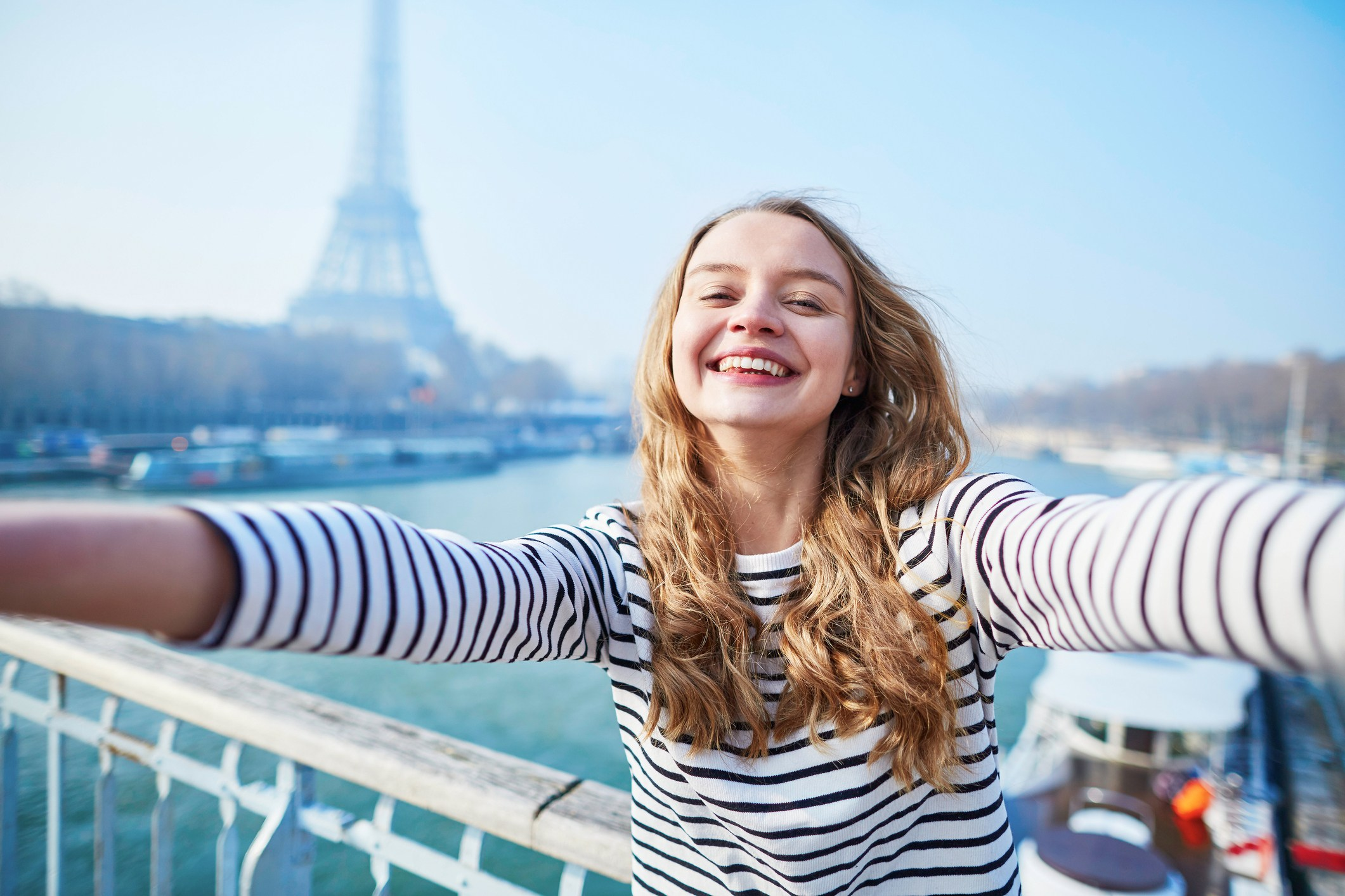 Girl taking a picture in Paris by the Eiffel Tower