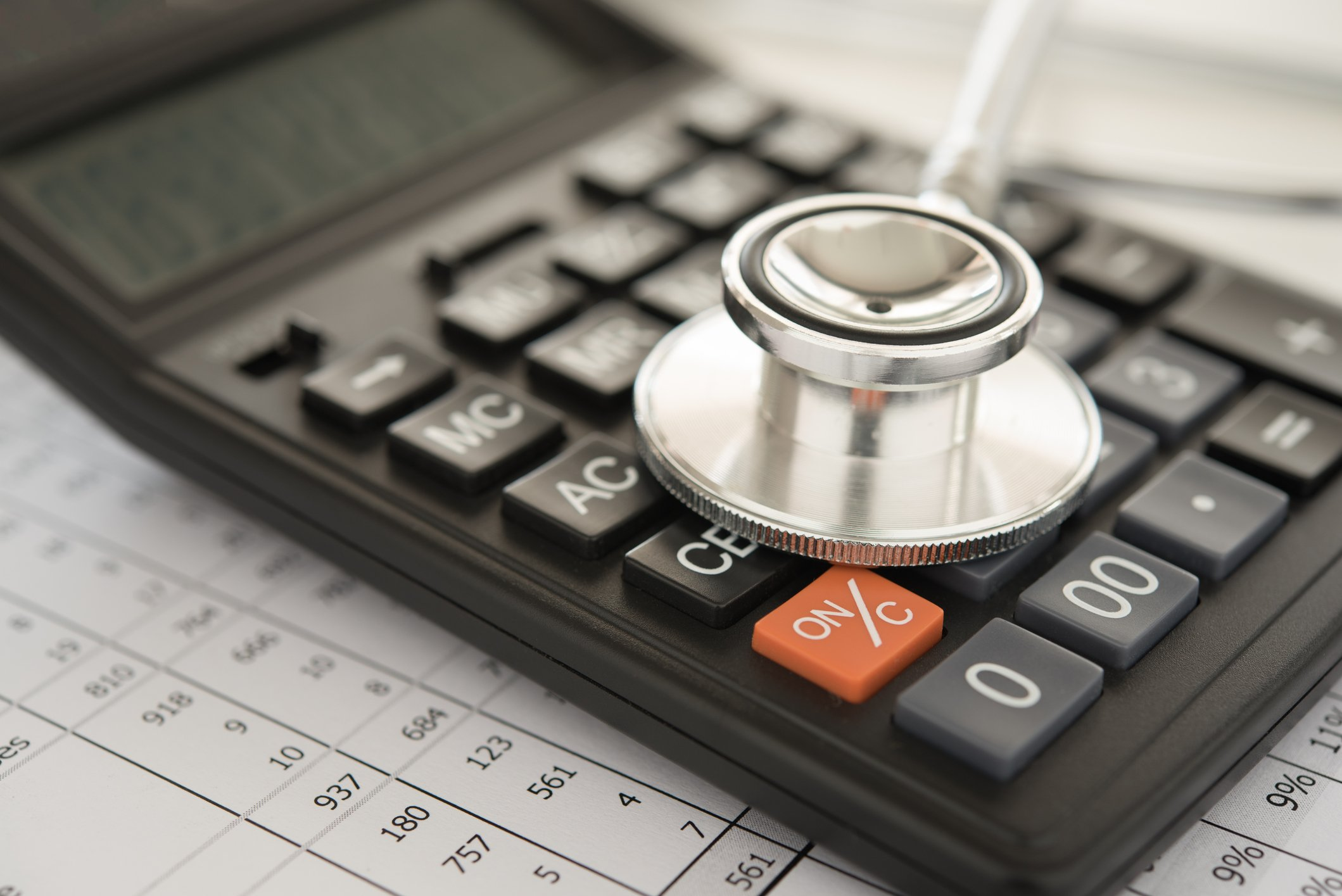 Health care costs concept with calculator