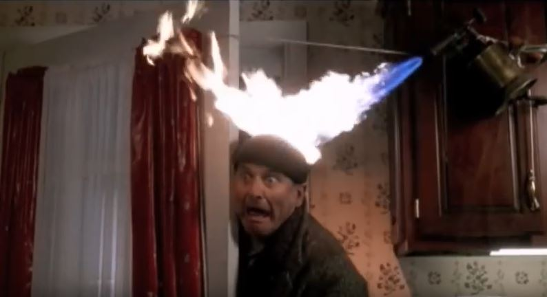 marv's head on fire with a blowtorch in home alone
