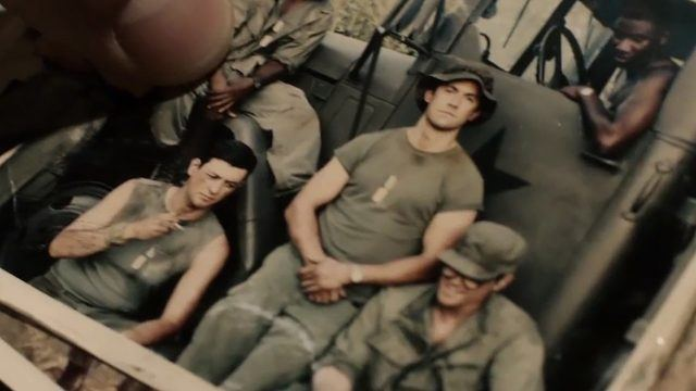 Jack Pearson (Milo Ventimiglia) holds a photo of himself and his brother Nick in Vietnam in a scene from 'This Is Us.'