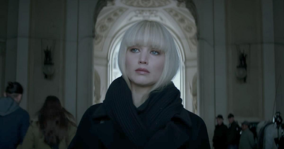 Jennifer Lawrence in a short platinum blonde wig