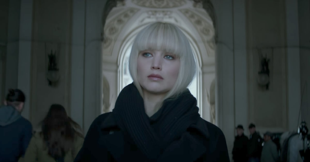Jennifer Lawrence in a short platinum blonde wig
