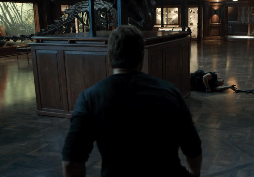 Chris Pratt in Jurassic World: Fallen Kingdom watching a fallen guard.
