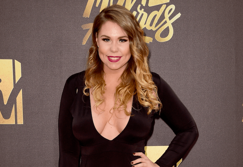 Kailyn Lowry poses in a black dress