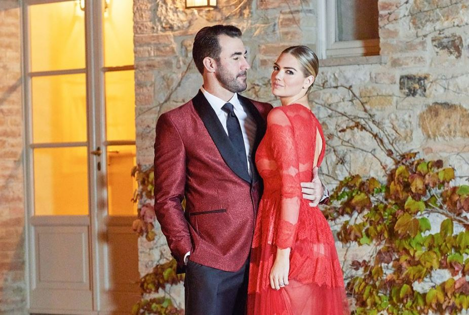 The couple in their rehearsal dinner red attire