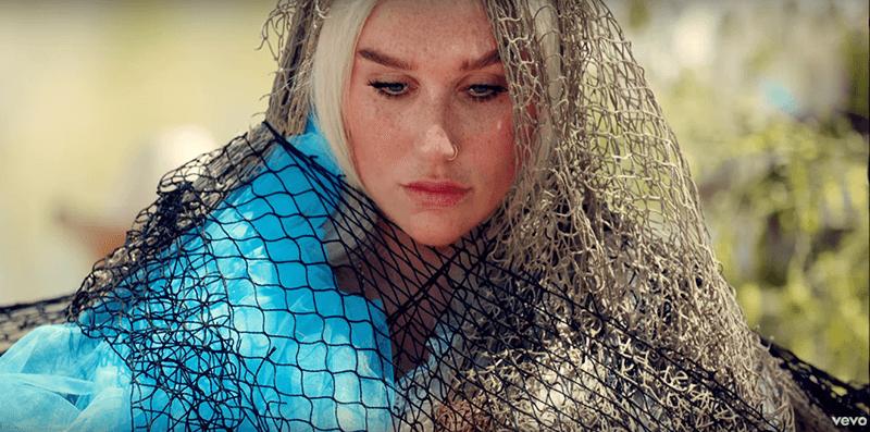 "Kesha wearing a net in the ""Praying"" music video"