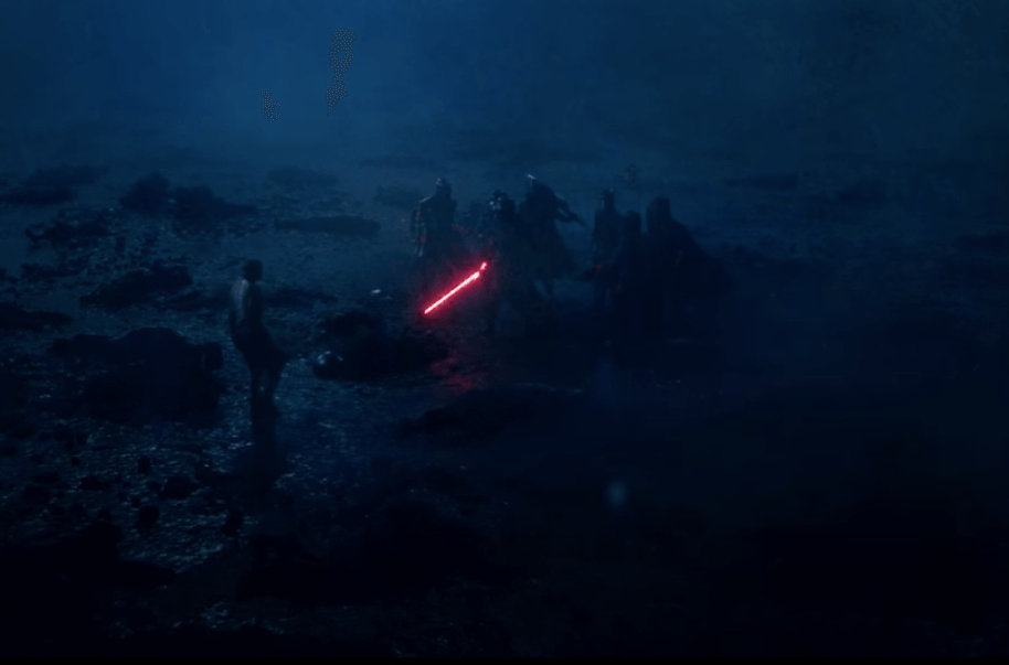 The Knights of Ren hold a glowing red lightsaber in Star Wars: The Force Awakens