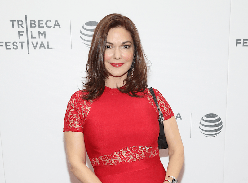 Laura Harring in a red dress