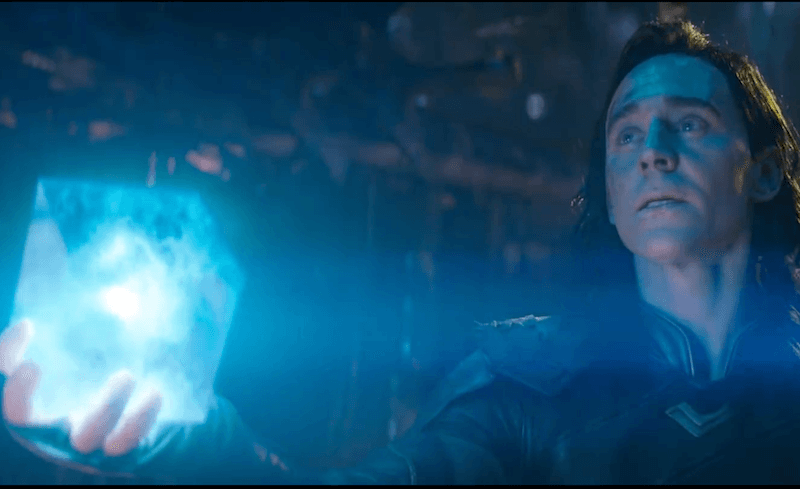 Loki holds up the Tesseract
