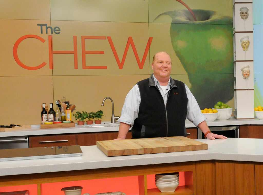 Mario Batali on The Chew standing in a kitchen