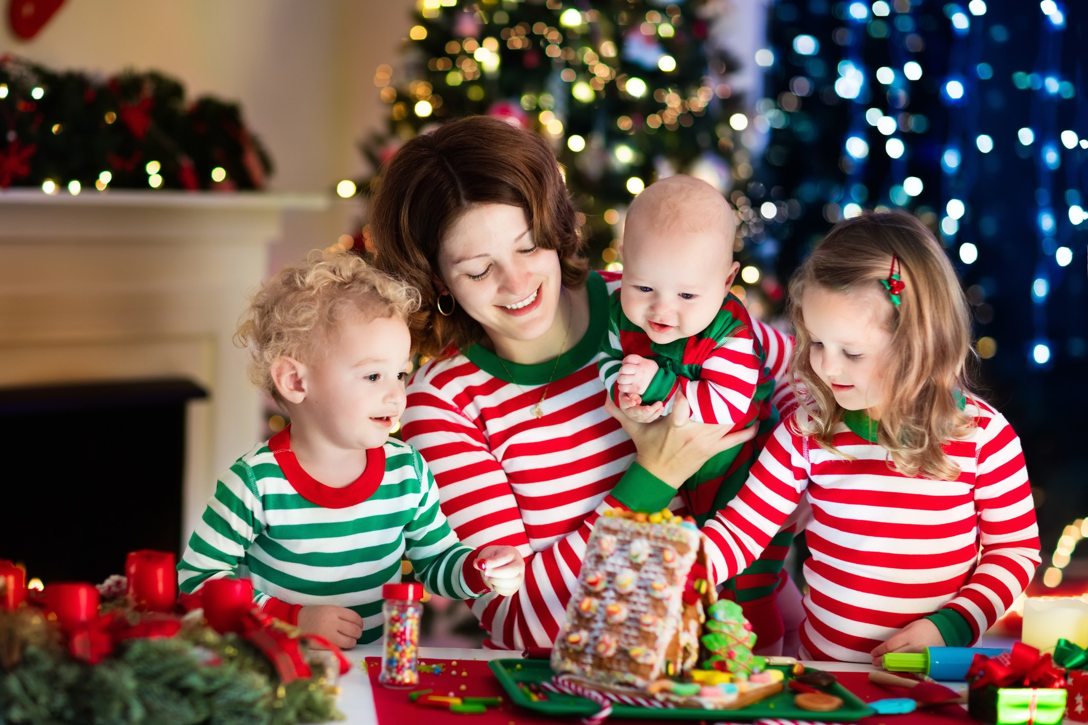 Mother and kids in matching Christmas pajamas