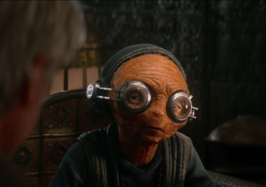 Maz Kanata asks Han Solo a question in Star Wars: The Force Awakens