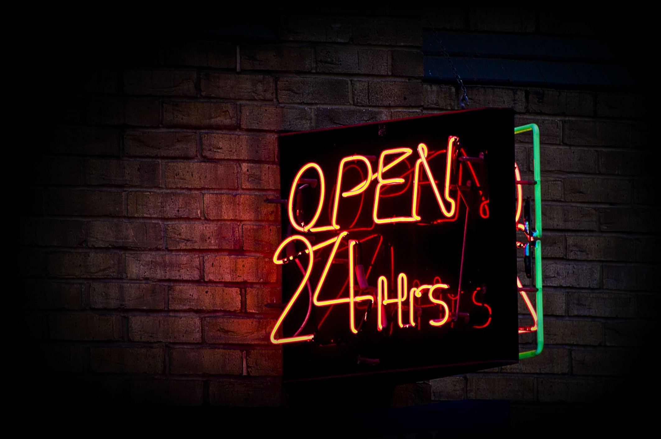Neon orange Open 24 hours sign