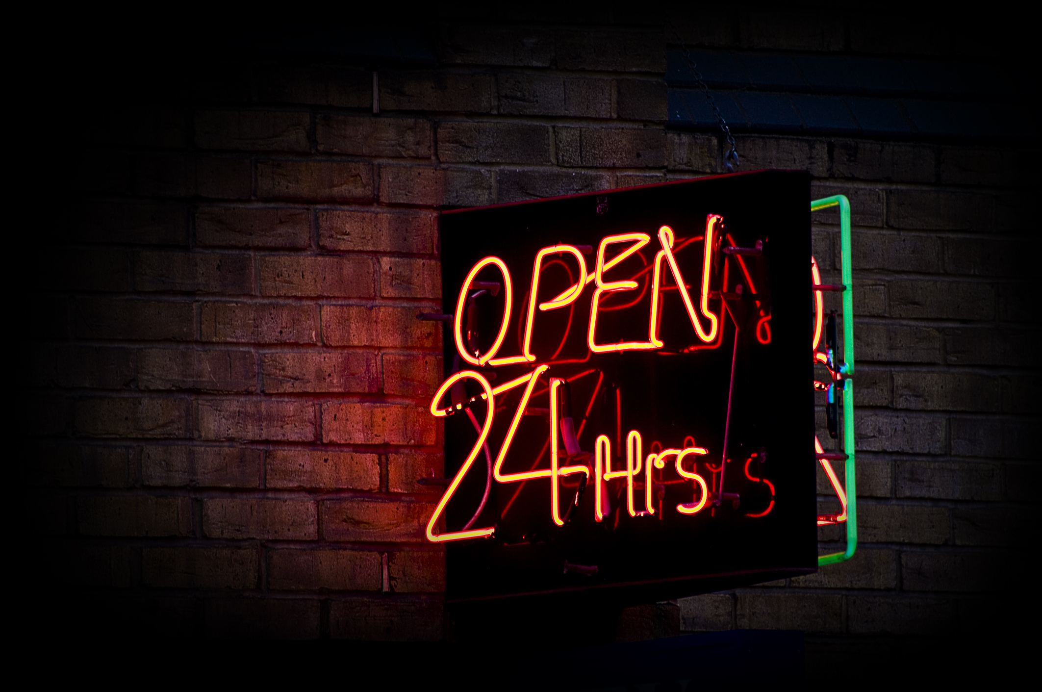 Neon orange Open 24 hours sign