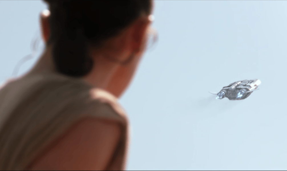 Rey watches a ship leave Jakku in a flashback in Star Wars: The Force Awakens