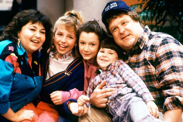 Roseanne sits with her entire family.