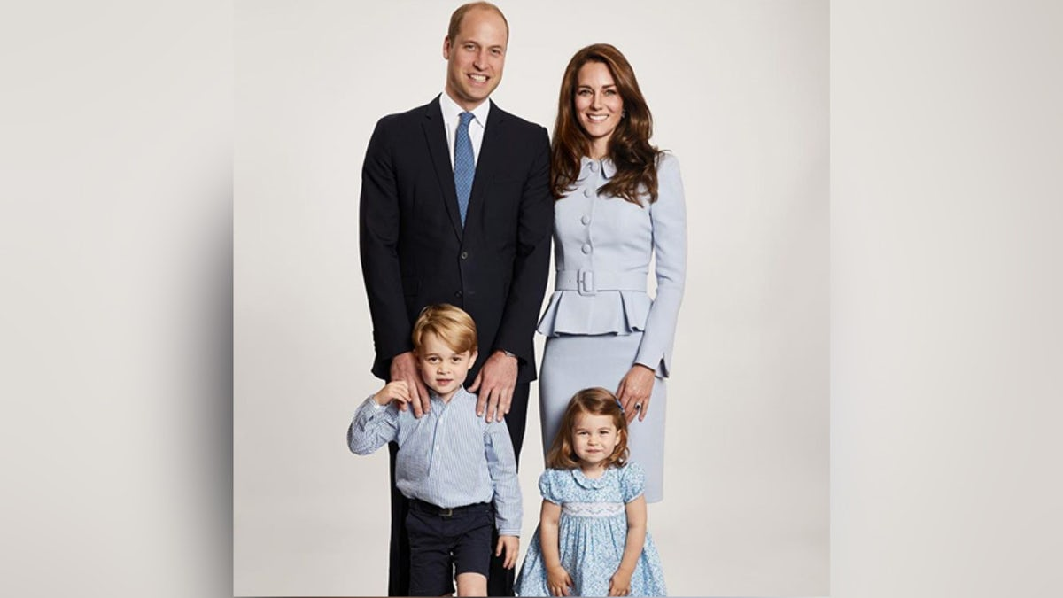 Kate Middleton, Prince William, Prince George, and Princess Charlotte pose in light blue clothes for their Christmas card