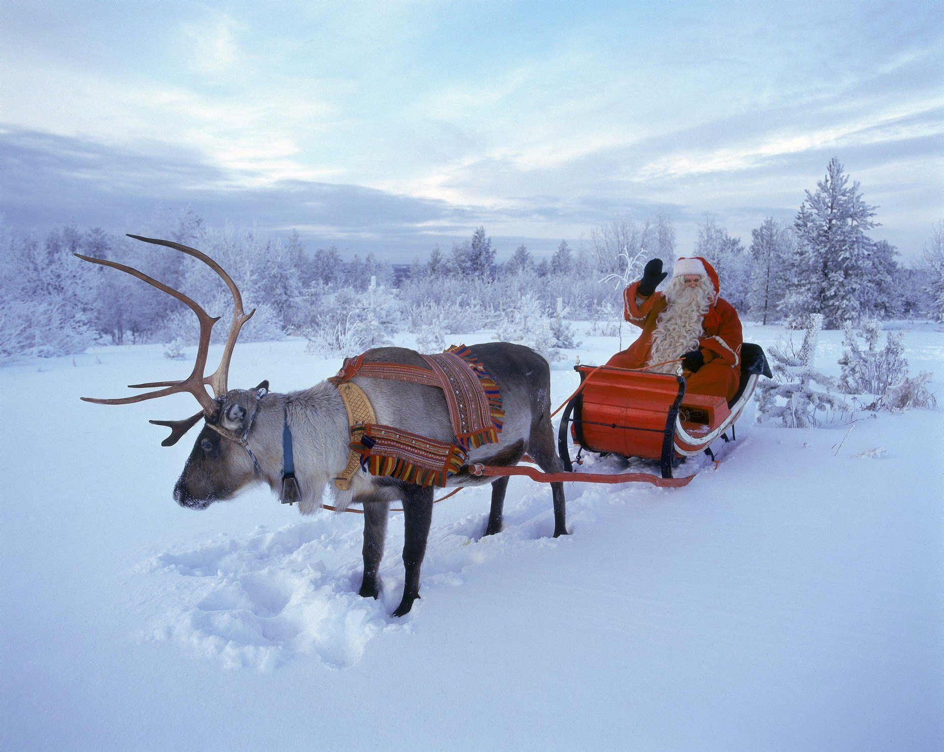 Santa Claus waves in Rovaniemi, Finnish