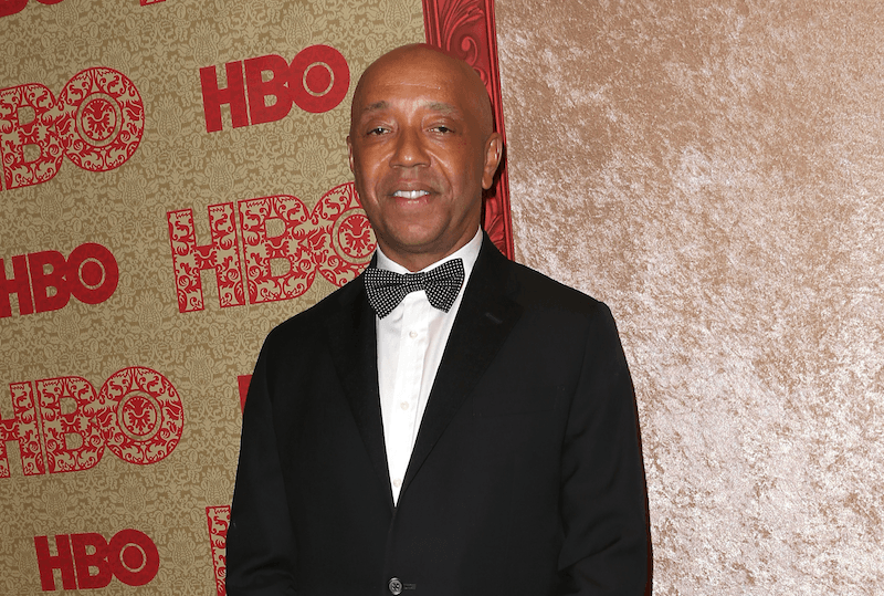 Russell Simmons poses in a tux at an HBO event