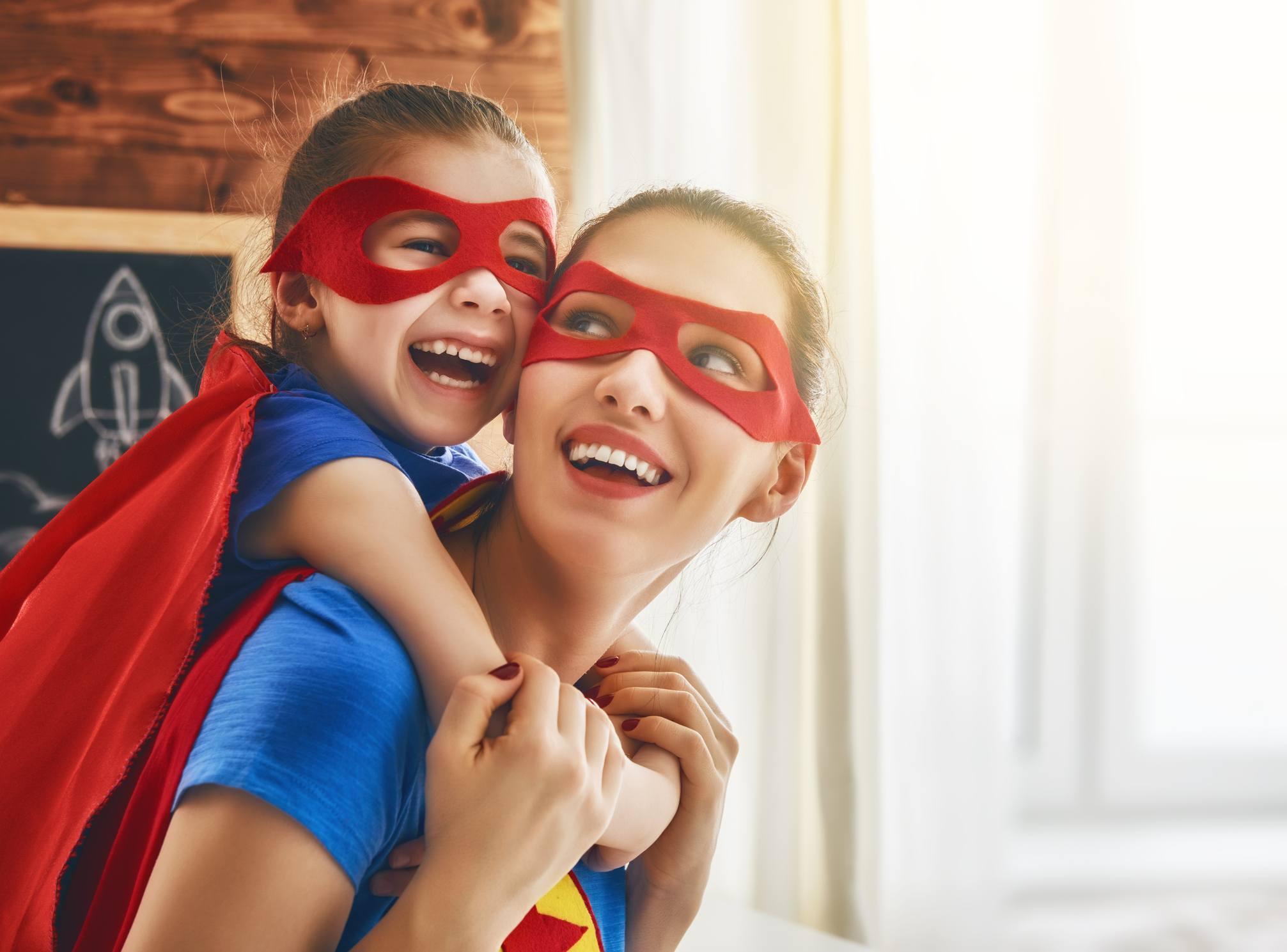 Girl and mom in Superhero costume