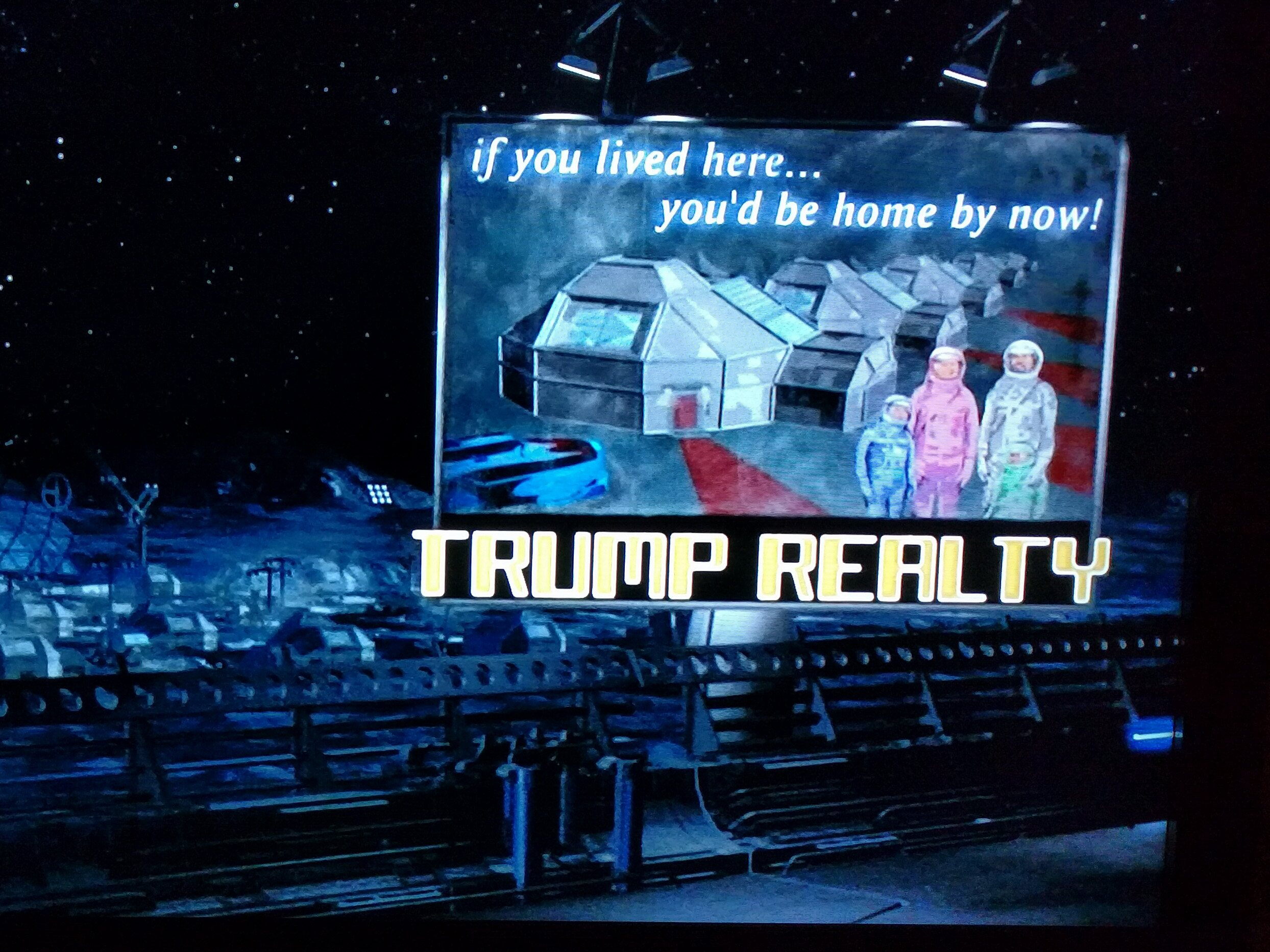 "A ""Trump Realty"" sign in The Adventures of Pluto Nash"