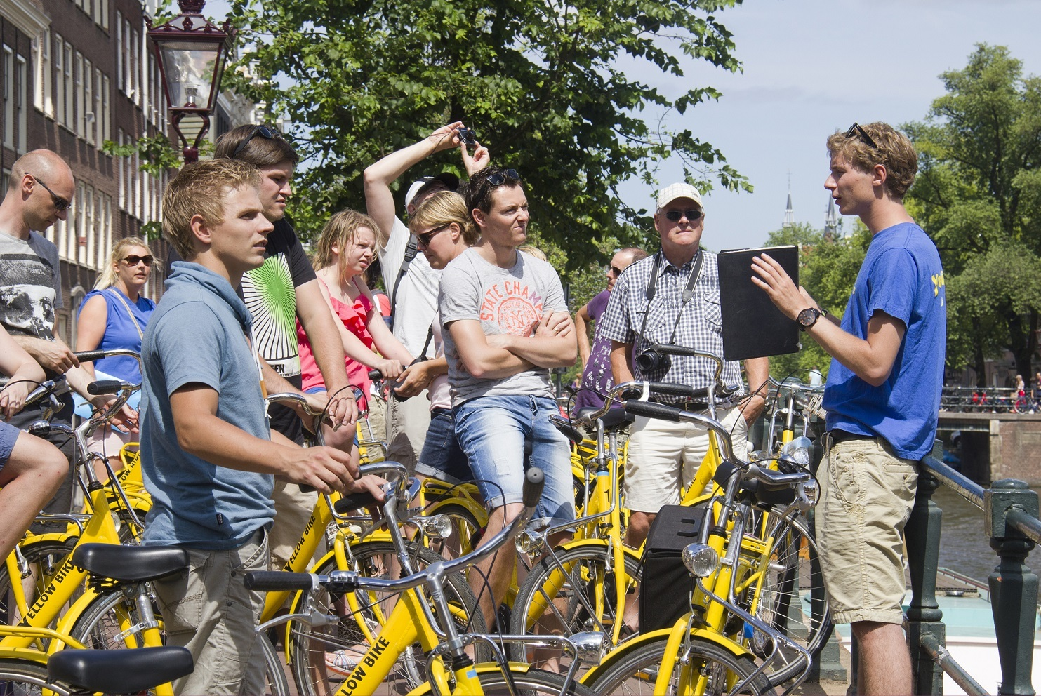 Tourists on bikes in Amsterdam for guided tour