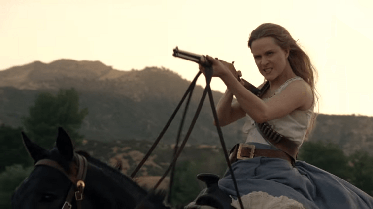 Dolores rides a horse and aims a gun in the Westworld Season 2 trailer