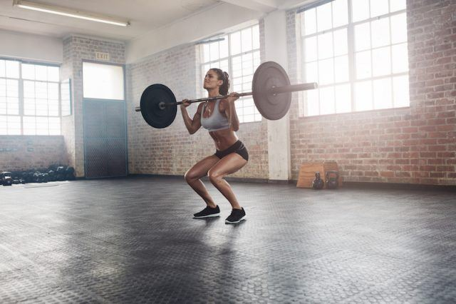 A woman doing a snatch lift.