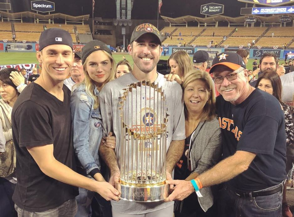 Justin Verlander, Kate Upton, and family holding a World Series trophy