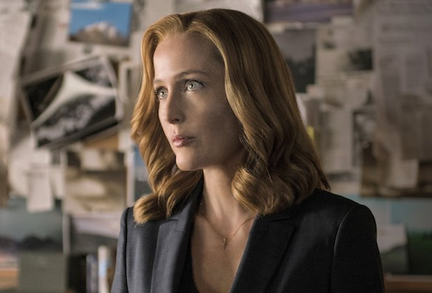 Scully stands in a black blazer