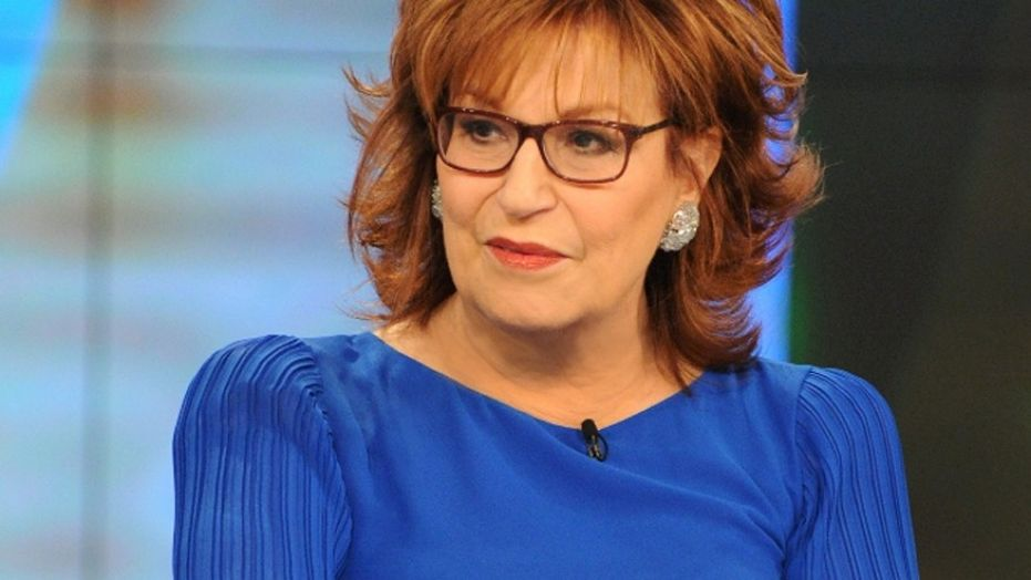 Joy Behar looks to the side