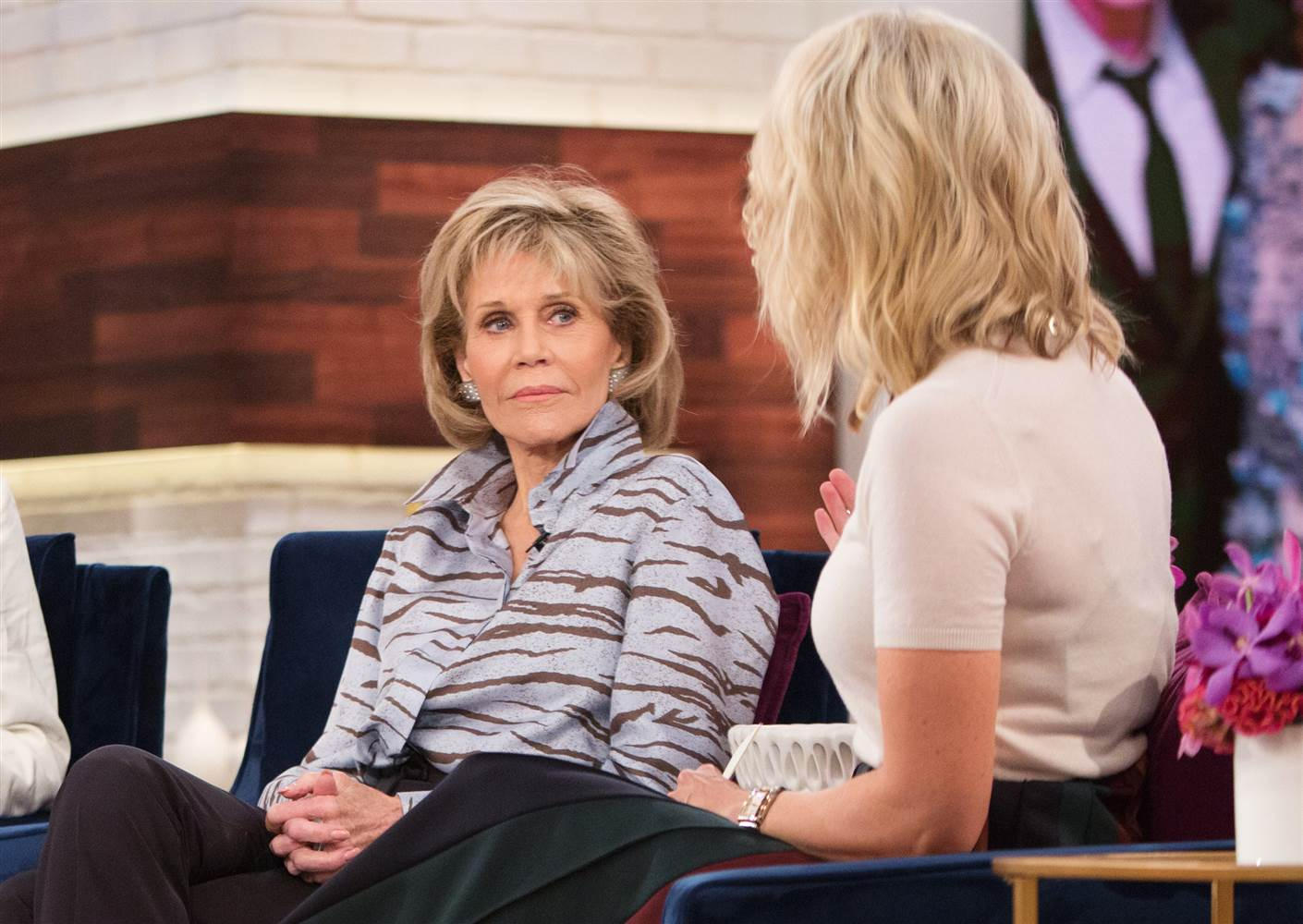 Jane Fonda sits across and stares from Megyn Kelly on her show