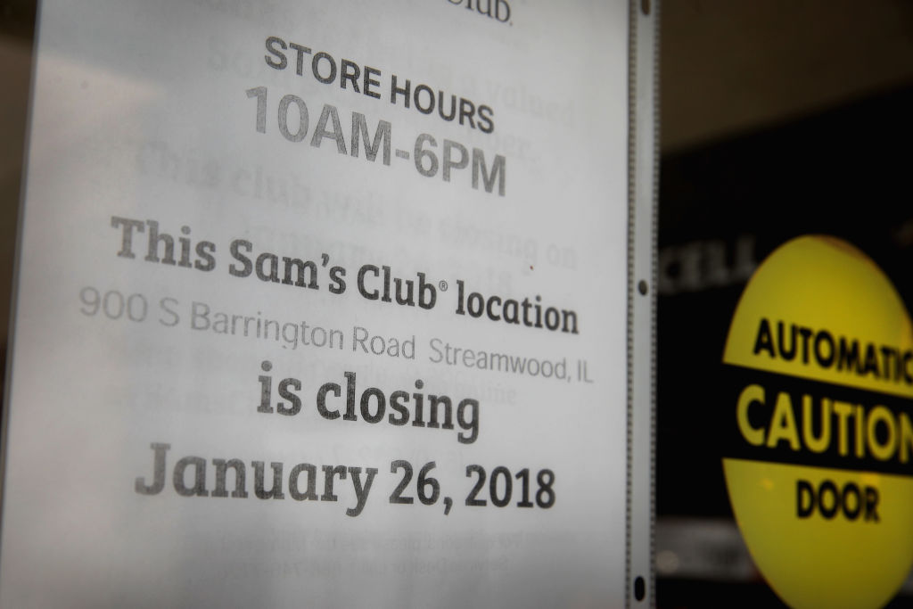A sign hangs on the door of a Sam's Club store in Streamwood, Illinois