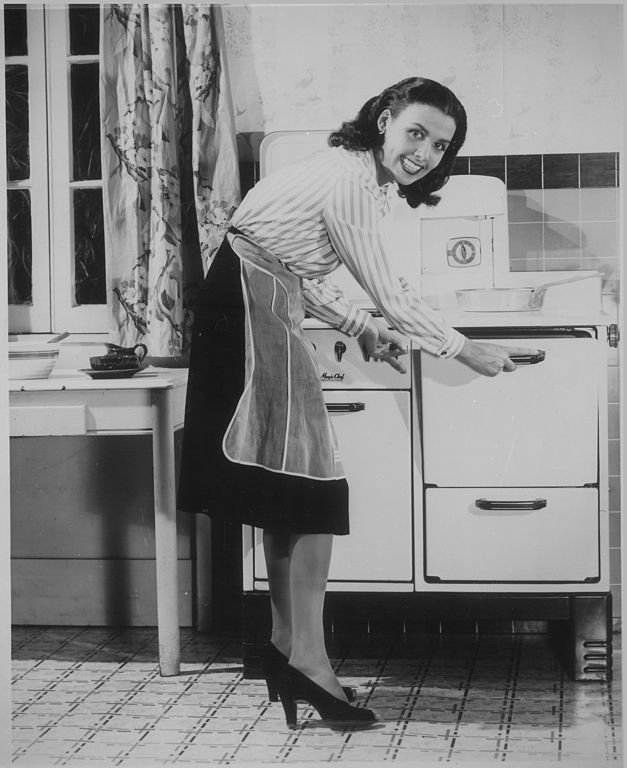 woman using a 1940s stove