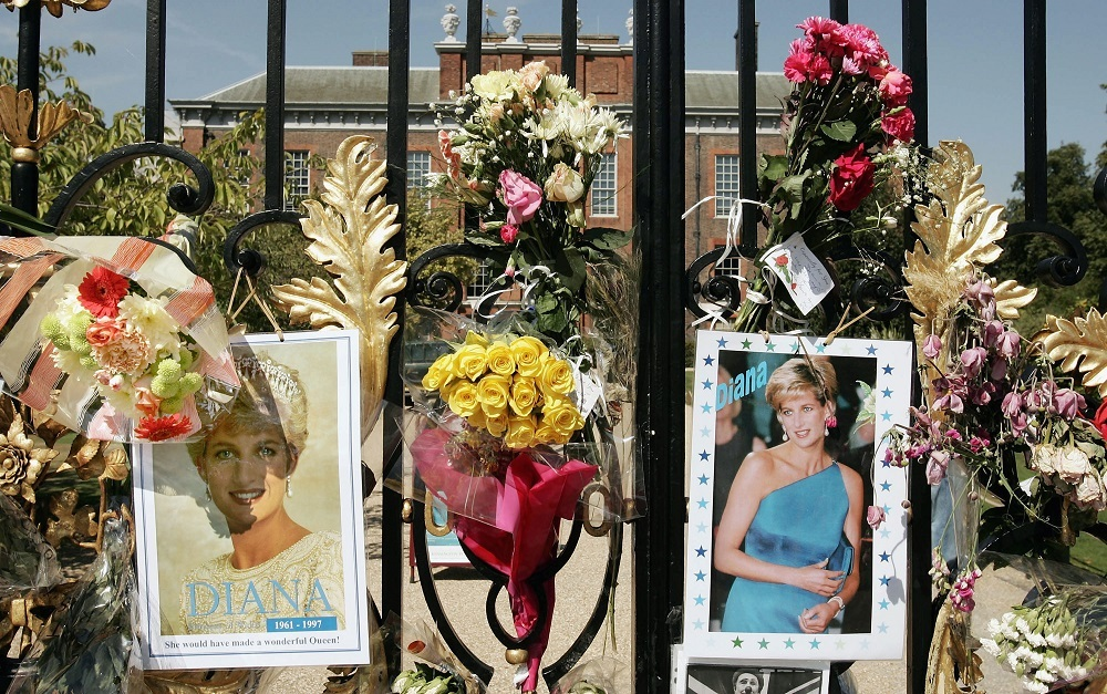 Flowers, photographs and tributes are placed in memory of Princess Diana