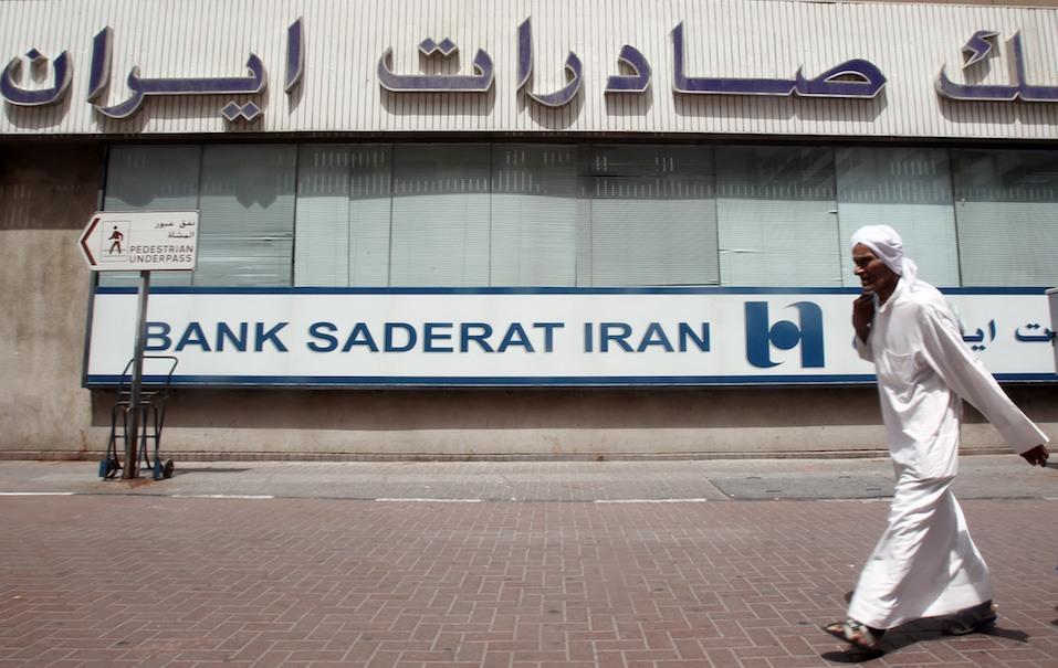 A man walks past Bank Saderat Iran one of the Islamic republic's top trading partners