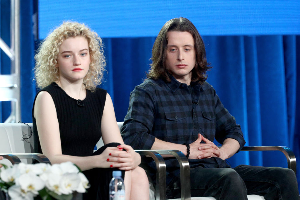 Julia Garner (L) and Rory Culkin of 'Waco' speak onstage