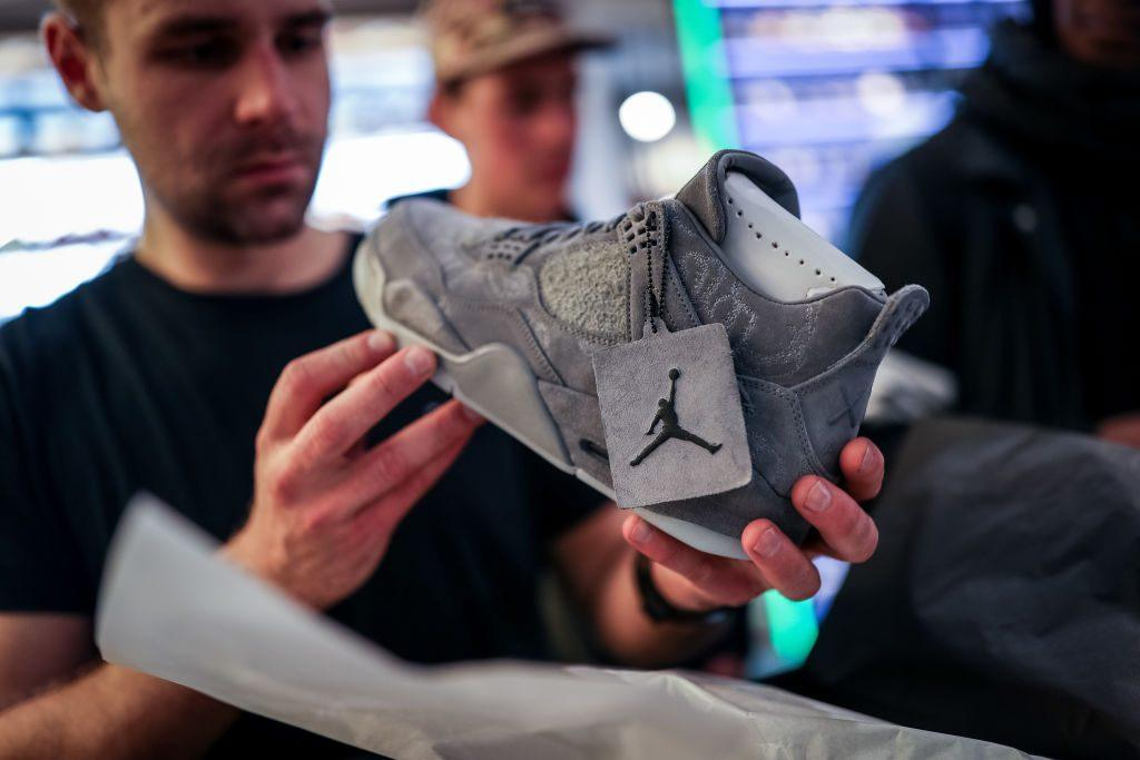 A customer looks at a new Air Jordan sneaker for sale.
