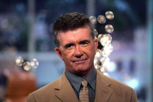 Alan Thicke in a brown suit and blue shirt.