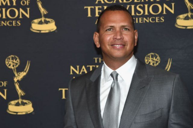 Alex Rodriguez smiling on a red carpet.