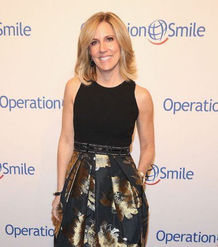 Alisyn Camerota posing in a skirt and top.