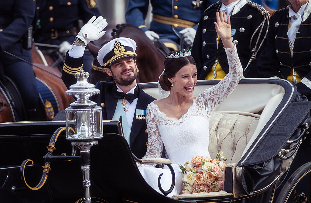 Prince Carl Philip of Sweden and his wife Princess Sofia of Sweden ride in the wedding cortege