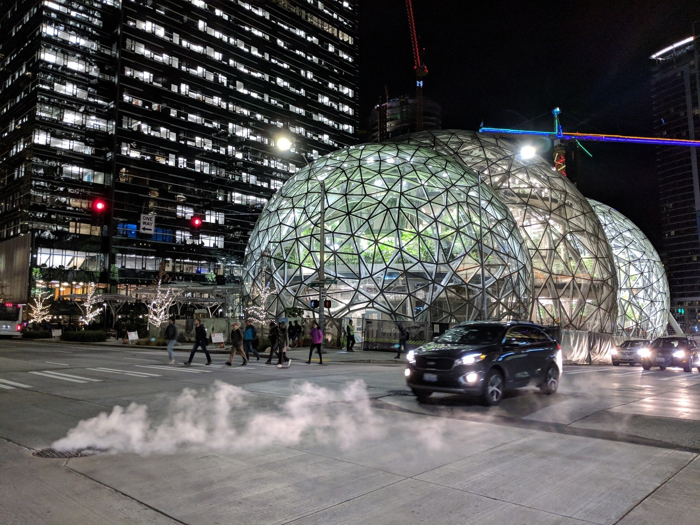 Workers Leave the Offices Outside Amazon Headquarters and Biosphere Domes