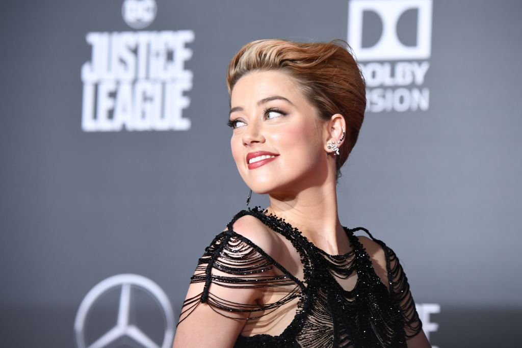 US actress Amber Heard poses as she arrives for the world premiere of Warner Bros. Pictures film 'Justice League'