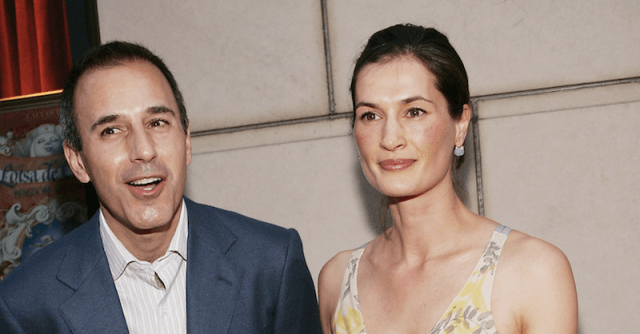 Matt Lauer and Annette Roque posing in front of a white building.